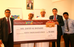 An Omani National wins US$50,000 cash raffle draw at Muscat Duty Free
