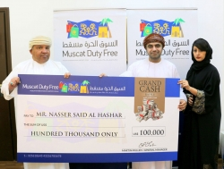 Omani National wins a hefty prize of US $100,000 in cash at Muscat Duty Free Grand Cash Raffle Draw